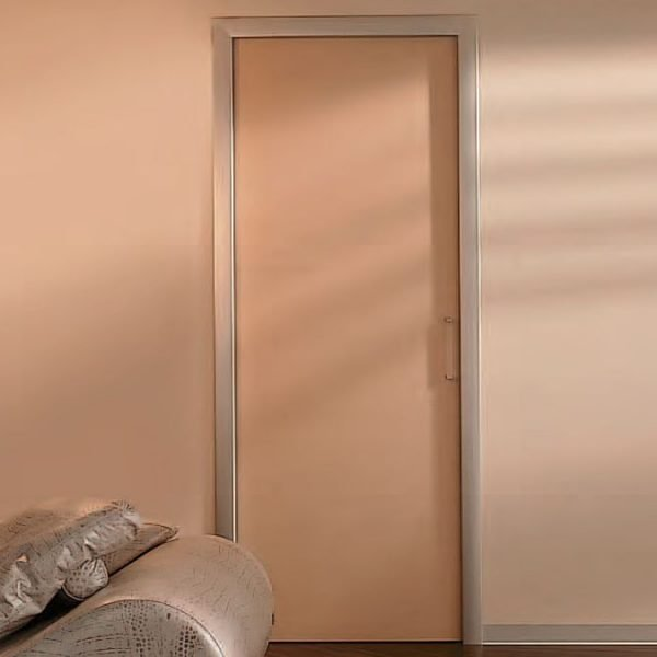Image shows minimalist sliding pocket door closed with architrave