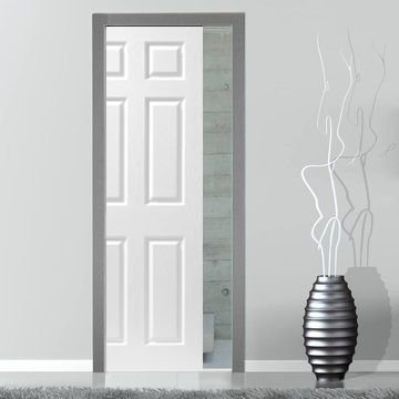 Image shows a six panel door sliding into the wall in a roomset