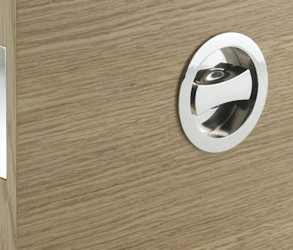 Image shows a close in picture of a flush handle and bathroom lock for use on a pocket door